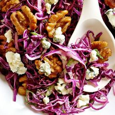 Serve this hearty salad recipe�combining red cabbage, blue cheese and glazed walnuts�as an accompaniment to roast pork or chicken.