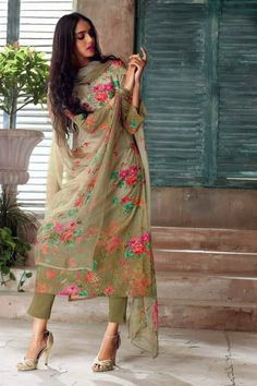 Olive Green Printed Suit Set Beautiful flower print all over the suit with dainty lace and swarovski on the neckline adds a touch of elegance to this Olive green suit set. It is paired with matching bottom and digital print dupatta. Pakistani Dress Design, Pakistani Outfits, Indian Outfits, Kurti Designs Pakistani, Kurti Pakistani, Indian Salwar Kameez, Dress Indian Style, Indian Dresses, Indian Attire