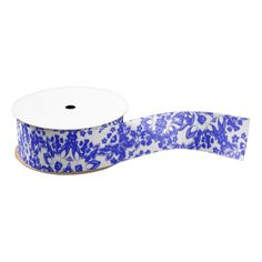 A pretty ribbon design in china blue and white; a stylish floral lacy pattern.