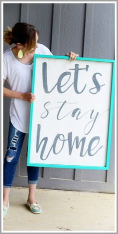 make your own wood quote sign stay home TIP- To aim for nice, crisp lines, paint a thin layer of the base coat of your board over the stencil first.
