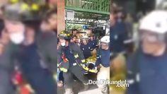 Bomberos atendiendo y sacando de la estacion a joven que se lanzo a las ...