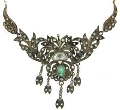 Antique Victorian, circa 1800, emerald and diamond necklace in gold and silver.