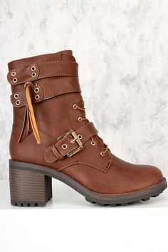 Doll up any outfit with these stylish boot! They will look super hot paired with your favorite skinnies or dress. Make sure you add these to your closet, it definitely is a must have! The features include faux leather upper, wrap around high polish buckle tie closure tassle detailing, stitched trim detailing, smooth lining, and followed by a  cushioned footbed. Approximately 3 inch chunky heel