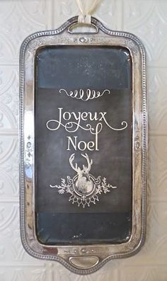An old Silver Tray with chalkboard paint becomes a beautiful sign for a Black, White & Silver Christmas! (Yes ... It's stunning! I'll be looking!)