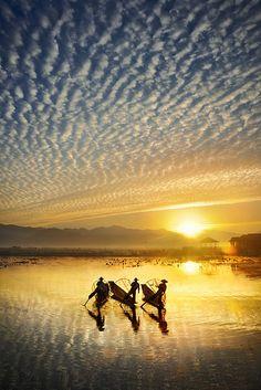 Early one morning on Inle Lake, Myanmar, Burmese fishermen