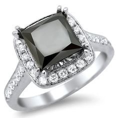 Black Princess Cut Pave Engagement Ring - This certified 3.02 carat Black Princess Cut Pave Engagement Ring is set in 18k White Gold & It features a quality 2.32 carat solitaire Black Princess Cut diamond is set atop the ring. It also comes with .70 carats of VS1-VS2 in clarity & E in color quality round diamonds that surround the stone. They are set on the top, sides & outsides of this beautiful ring. The top measures 10.50mm wide & all of the diamonds are 100% natural…