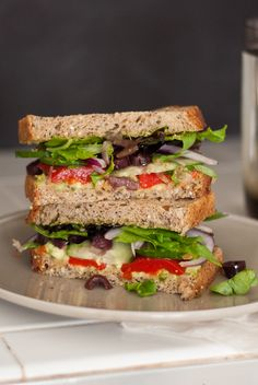 Greek Avocado Sandwich    Ingredients        2 slices soft whole wheat bread      1/2 avocado      1 tablespoon basil pesto*      roasted red bell pepper (jarred is fine)      cucumber, sliced into thin rounds      thinly sliced red onion      6 pitted kalamata olives, thinly sliced      handful spring mix      balsamic reduction or regular balsamic vinegar
