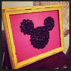 """My mom made me this Mickey Mouse art! She's so good at this stuff! - Glue black buttons to red paper in the shape of Mickey. Overlap and add in some """"fancy"""" buttons throughout. Paint a black frame yellow and rough the edges to distress. Easy as that! @Mitzi Hose"""