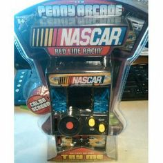 "NASCAR ""Red Line Racer"" Color LCD Penny Arcade by NASCAR. $12.98. Classic arcade design; Color LCD Screen; Multiple levels, music and sound effects; Start the game with a the push of a button or drop a penny!. From the Manufacturer                We packed the non-stop energy and excitement of NASCAR into an arcade game! Drop a penny into the coin slot, grab the wheel, and take control of your racecar in REDLINE RACIN'! Get behind 500 horses and tear around the track to the ..."