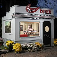 Should your kids not be satisfied with the little play kitchen and teacups that their friends have, the Duffy's Diner Playhouse will do the trick. I hope they learn to make a good black-and-white milkshake in there.