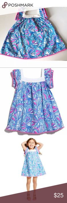 "RARE Lilly Pulitzer for Target ""My Fans"" Dress 18M Lilly Pulitzer for Target ""My Fans"" Toddler Dress, size 18 months. Blue, pink, and white seashell print. Fully lined dress with white eyelet neckline and pink Pom-Pom trim on sleeves and bottom hem. 100% cotton. Approximate measurements, laying flat: 11"" underarm to underarm, 17.75"" length. Worn once, hand-washed, laid flat to dry. Lilly Pulitzer for Target Dresses Casual"
