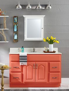 Refresh a basic oak cabinet by removing the hardware, sanding the wood, and finishing it with primer and a high-gloss paint. New hardware and a fresh faucet complete this colorful vanity makeover.