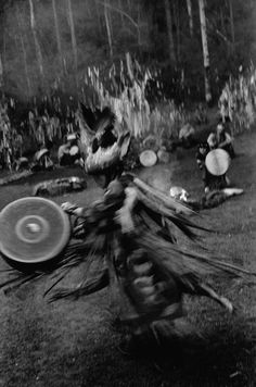 Shaman AY CHUREK leads a kamlaniye (ritual with fire) in the taïga surrounding sacred arjans (water springs).