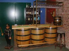 The Prop Room Toronto - Bar and Pub items Barrel Bar : #493- Bar made from 1/2 barrels, brass glass rack optional. Measures 26D x 86L x 37H., for rent.