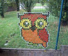 Owl cross stitched on a fence Urban X-Stitch: Street Artist Cross-Stitches Yarn on Fences