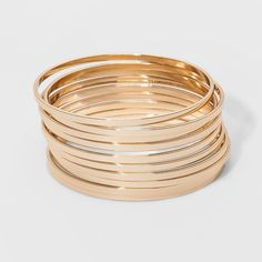 10 bangle bracelets are a great staple accessory piece. Stylish bangles look great when worn together matched with other jewelry. Gold Bangle Bracelet, Bangle Set, Diamond Bracelets, Metal Bracelets, Link Bracelets, Bracelet Set, Jewelry Bracelets, Gold Necklace, Chain Necklaces