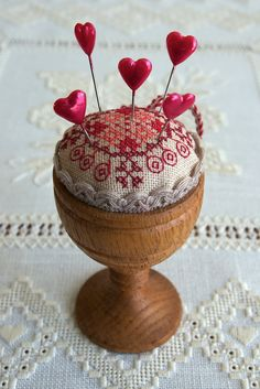 Egg Cup Pincushion with Cross Stitch Embroidery . Spool Crafts, Sewing Crafts, Sewing Projects, Embroidery Hoop Crafts, Cross Stitch Embroidery, Cross Stitch Finishing, Crochet Amigurumi, Wooden Spools, Thread Spools