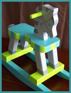 Rocking Horse (hand painted . wooden . modern . whimsical). $185.00, via Etsy.