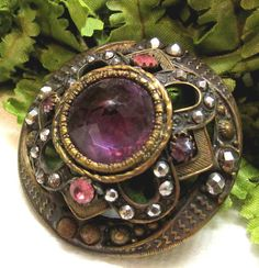 """gorgeous antique late Victorian """"gay 90's"""" button : layered domed brass with faceted amethyst glass jewel, pastes and cut steel accents"""