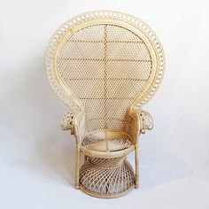 Hand crafted Rattan Loop Peacock chair. Beautiful raw rattan natural finish. Includes round white canvas cushion.