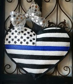 Check out this item in my Etsy shop https://www.etsy.com/listing/262309543/back-the-blue-police-officer-heart-flag