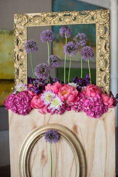 flower arrangement art installation with allium, dahlias, peonies, sweet peas, and hydrangea.
