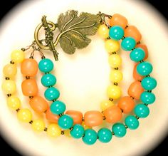 Pastel yellow, tangerine and turquoise beaded bracelet. I LOVE this color combo--I need to make something with this palette sometime.