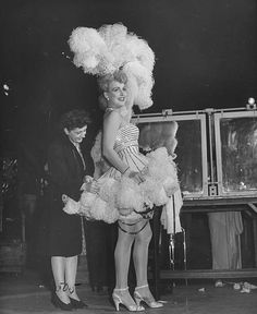 """Chorus girl having costume adjusted during filming of the movie The Ziegfeld Follies"" Still Image, Image Now, Ziegfeld Girls, Ziegfeld Follies, Josephine Baker, Video Site, Showgirls, Burlesque, Documentaries"