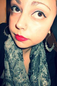 Light lavender eye shadow, black eyeliner & mascara, with red lipstick.