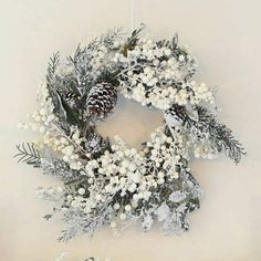 A stunning christmas wreath made from white berries , fir and pinecones all dusted with glistening snow.This beautiful Christmas wreath will make a wonderful statement on a front door this Christmas. The natural wicker wreath is trimmed with white snowy berries , large pinecones and fir branches all dusted with a generous amount of white as if the snow has just fallen outside. It is suitable for hanging outdoors and can be re-used year after year. It could also be hung above a mantelpiece or…