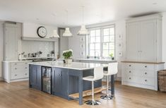 Farrow & Ball's Pavilion Grey on the cabinetry and Railings on the island unit