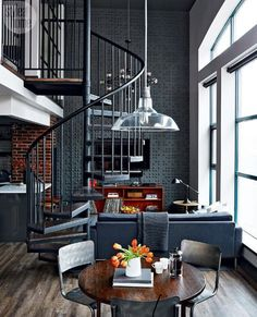 dark brick and tile loft space with spiral staircase