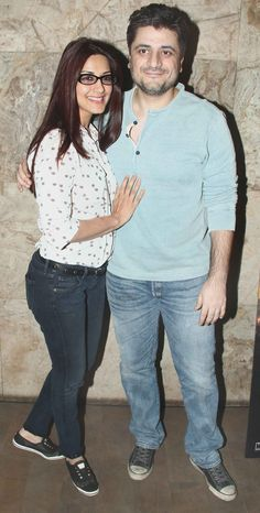Sonali Bendre and husband Goldie Behl at a screening of 'X-Men: Days of Future Past'. #Style #Bollywood #Fashion #Beauty