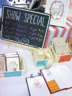 Craft fair display tip: Use signs to reinforce your brand, explain your products and encourage a sale. Chalkboard signs allow you to update specials.