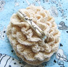 A crochet coin purse from Craftzine!  Isn't it lovely?  I can see this being carried for dressy occasions like a wedding, prom, or just a fun night on the town.  In bright colors, like shocking pink, they would be fun accessories for even a blue jeans day!