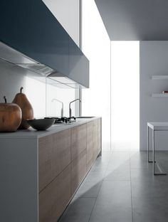 *Modern, minimal kitchen design, white interiors* - New from GD Cucine, Seta has a Zen-like, understated simplicity. Flat doors offer a clean backdrop for a variety hardware profiles including a recessed pull that virtually disappears in a linear composition along the top or bottom of the drawers or cabinets. With its ample enclosed storage, both floor standing and wall hung, Seta can be customize.