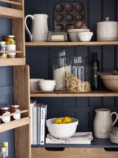 Throw open the simply panelled double doors and a whole world of versatile kitchen storage opens up in the form of shelves, racks and a drawer, ready to look after spices, packets, jars, tins and more. And at the bottom, all your cutlery, utensils and tableware will find a home in the four roomy drawers with smart metal cup handles. Offering timeless style that will suit any décor, it will work equally well in modern and traditional kitchens.