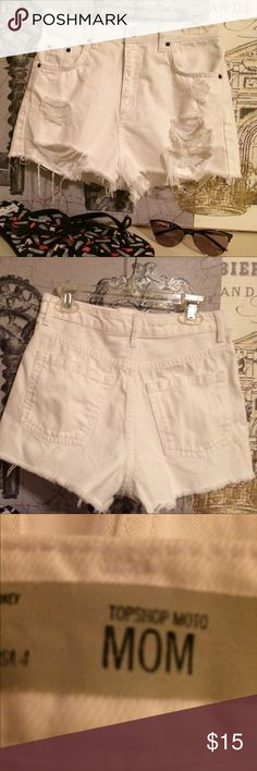 Topshop high waisted white distressed denim shorts The perfect summer shorts with distressed detail & raw edge hem!  EUC.  Run small more like 0-2. Topshop Shorts Jean Shorts
