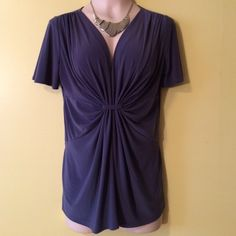 """Daisy Fuentes Top Pretty top with cape sleeves and flattering gathered front. 85% polyester and 5 % spandex. The 2nd and 3rd pics are the actual color. It's a gray and fabric has a sheen to it. 28"""" in length. Daisy Fuentes Tops"""