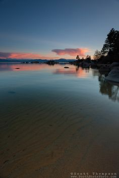 Sunset at Lake Tahoe 23- This sunset and ripples in the lakeshores sandy bottom were photographed at Speedboat Beach, Lake Tahoe.