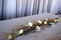 If you're looking for a different way to decorate your table, take a look at this curly willow garland with fabulous centered stock. roses, and accent crystals. Flower Centerpieces, Wedding Centerpieces, Wedding Table, Diy Wedding, Wedding Ideas, Bridal Table, Centrepieces, Wedding Arrangements, Table Arrangements