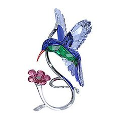 Beautifully executed in full color crystal, this stunning sculpture captures the power and beauty of the hummingbird in flight