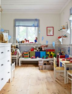 Keep the room a nautral colour and use toys and soft furnishings to add colour to a child's room