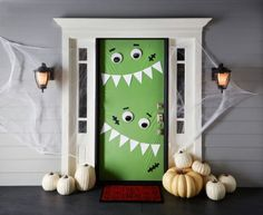 11. Cute Green Monsters - 30 Monster Doors and Monster Wreaths to Greet Trick-or-Treaters This Halloween