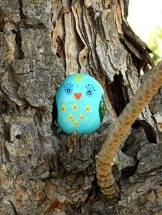 Turquoise painted rock owl.