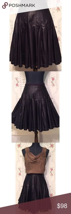 """Ted Baker London Full Skirt Grosgrain Waist NWOT NWOT skirt by Ted Baker London is a very full cotton/poly blend. Machine washable. Size 3 translates to an American Medium. The color is somewhere between black, dark purple and raisin and really stunning. Length 21"""" and waist measures 16"""". Ted Baker London Skirts A-Line or Full"""
