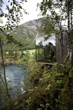 """The Juvet Landscape Hotel is located at Valldal, near the town of Åndalsnes in north-western Norway. Passing tourists are attracted by a spectacular waterfall in a deep gorge near the road, ""Gudbrandsjuvet""."