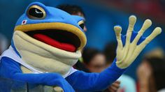 A fan dressed as a frog waves during the 2014 FIFA World Cup Brazil Group C match
