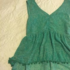 Green Pompom shirt Nice V neck and back. Ties at the back. Buttons on the front great condition and Pompom trim around the bottom. American Rag Tops