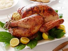 Use lemon, garlic and thyme to flavor Ina Garten's Perfect Roast Turkey recipe from Barefoot Contessa on Food Network, great for the holidays or just dinner.